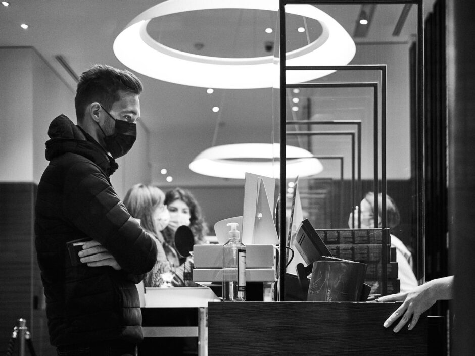 Black & white image of a young man in a Nespresso shop